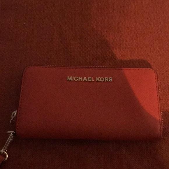 Michael Kors Handbags - Michael Kors Orange wristlet wallet